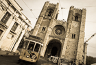 Tram 28 passing Lisbon Cathedral